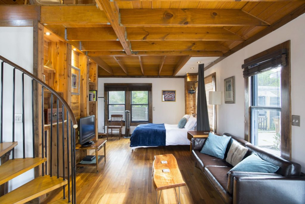 This listing in Austin ha added height to its living room and bedroom by exposing its beams and rafters.