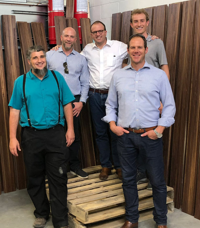 The TWA Hotel team visited Amish woodworker Joe Yoder, far left, at his Ohio factory to watch the tambour production process.